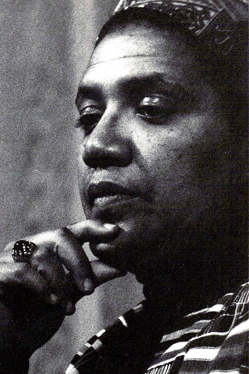 a black and white photo of a Black woman with short hair in profile