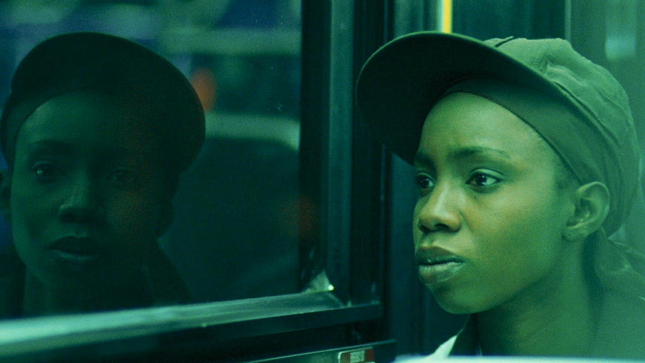 a Black queer woman rides the bus