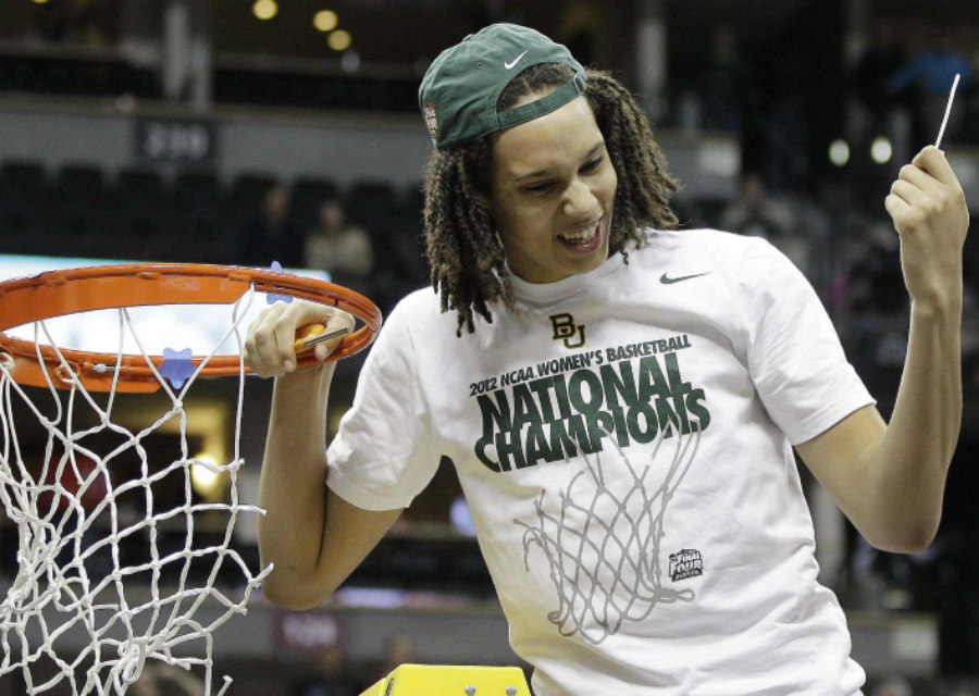 Brittney Griner cutting the March Madness net after winning the 2012 National Championship