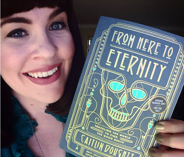 Caitlin Doughty holding From Here to Eternity