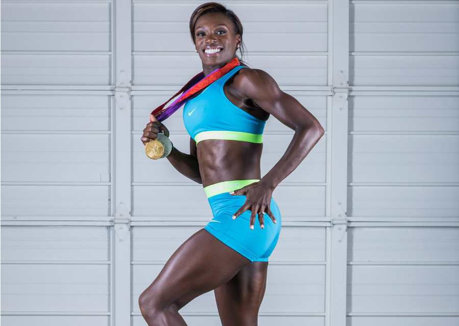 Dawn Harper-Nelson posing with her 2008 medals from Beijing