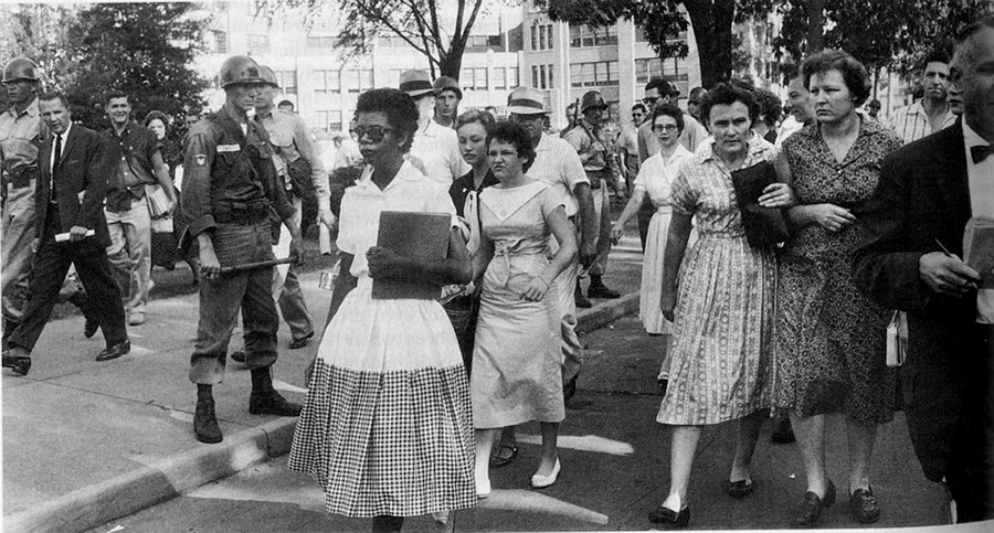 Elizabeth Eckford integrating a school in Little Rock, Arkansas