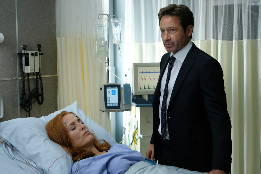 Gillian Anderson as Agent Dana Scully and David Duchovny as Agent Fox Mulder on The X-Files