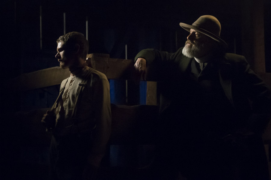 Jack O'Connell as Roy Goode and Jeff Daniels as Frank Griffin in Godless