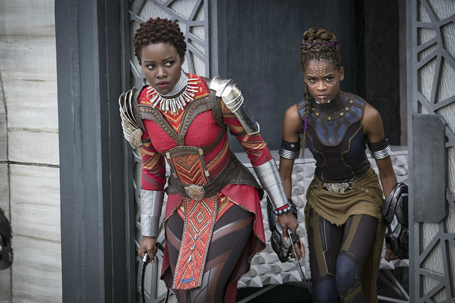 Lupita Nyong'o as Nakia and Letitia Wright as Shuri in Black Panther
