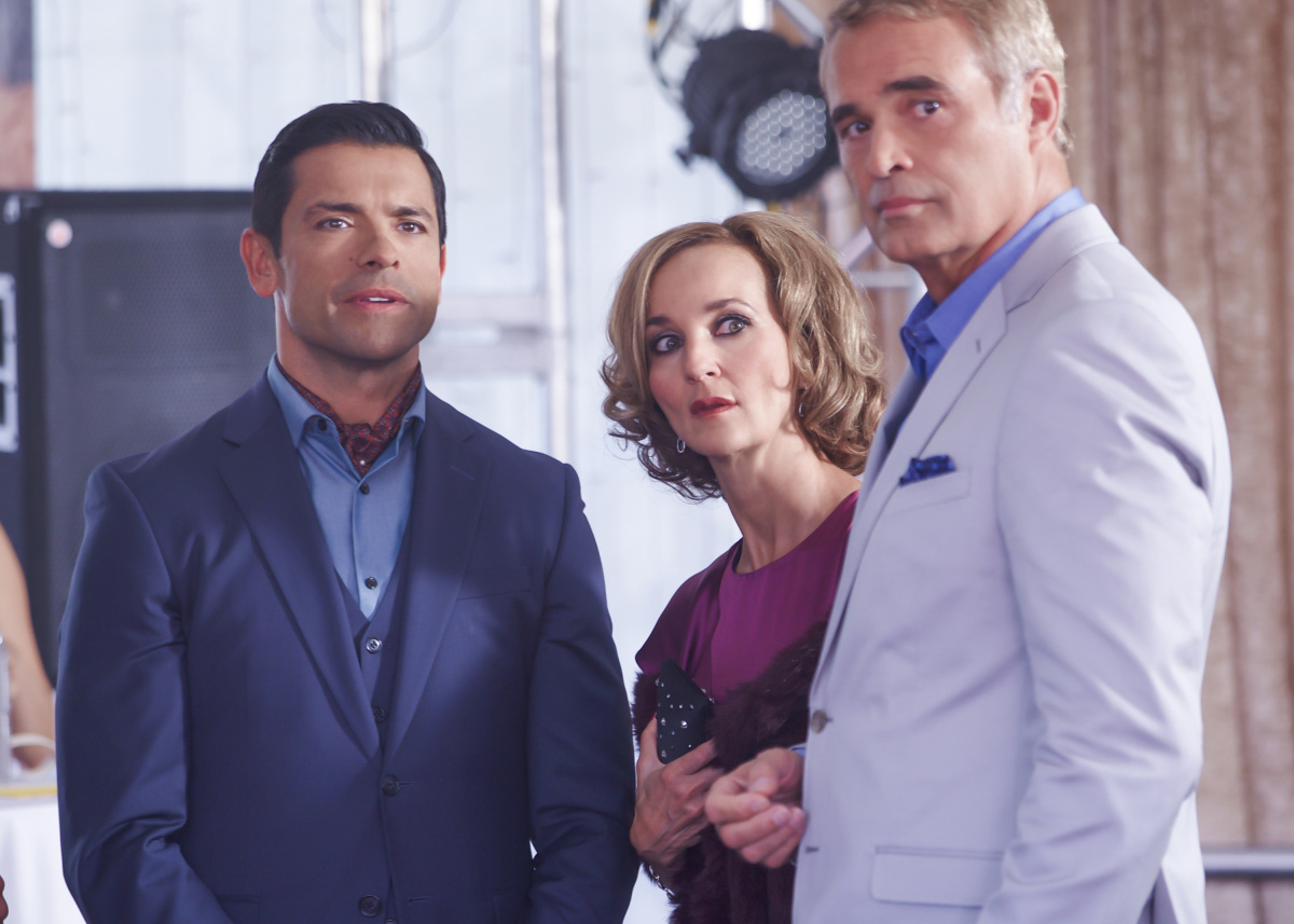Mark Brandon as Xavier St. Clair, Mark Consuelos as Hiram Lodge, and Michelle Brezinski as Simone St. Clair in Riverdale