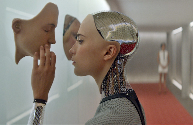 Image from the film Ex Machina of a female-coded cyborg examining her own face