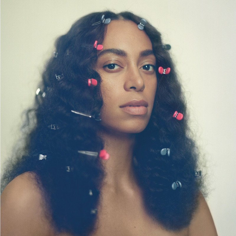a Black woman with shoulder-length hair rolled with bobby pins on an album cover