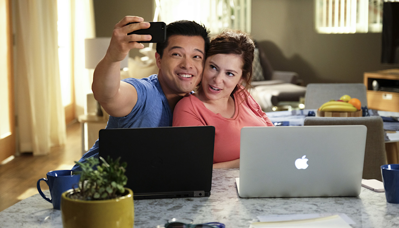 a mixed-race couple cuddles and smiles for the camera on Crazy Ex-Girlfriend