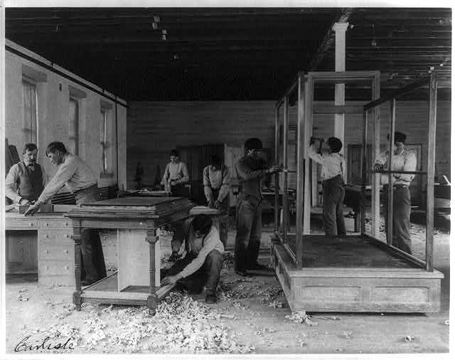 Indigenous students build furniture at the Carlisle Indian School in 1901