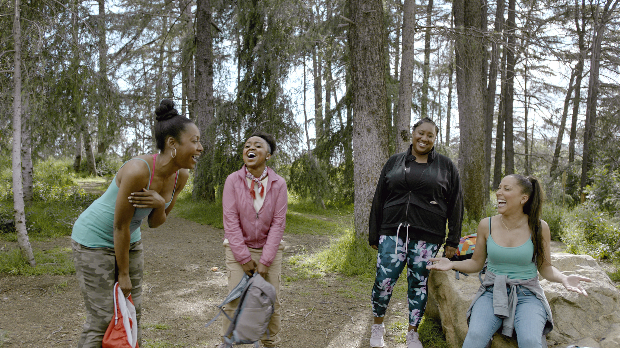 A photo of Gabrielle Dennis, Quinta Brunson, Ashley Nicole Black, and Robin Thede, Black women wearing athletic clothes and standing outside,  in A Black Lady Sketch Show