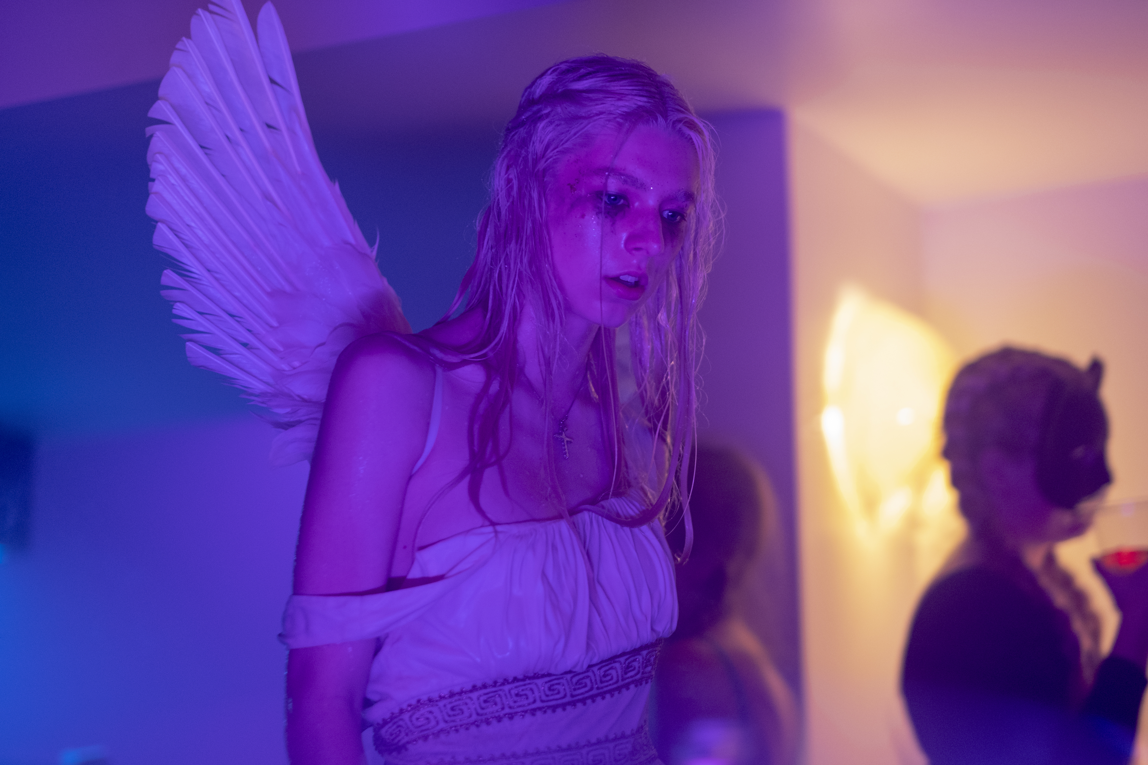 """A photo of Jules from """"Euphoria."""" Jules is crying, her eye makeup smeared, and wearing an angel costume."""