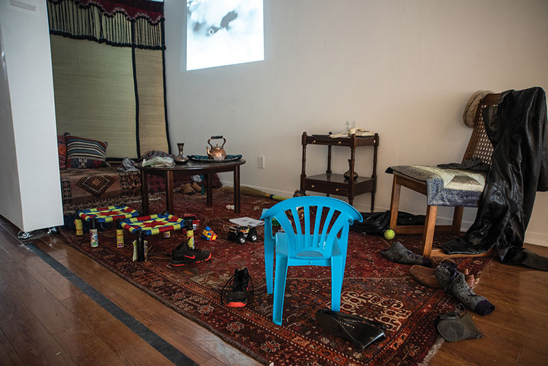 """""""Us and Them"""" 2018 by N. Fatima recreates a home filled with the lingering presence and traces of lives left behind, demonstrating the impact of Drone attacks in Pakistan."""