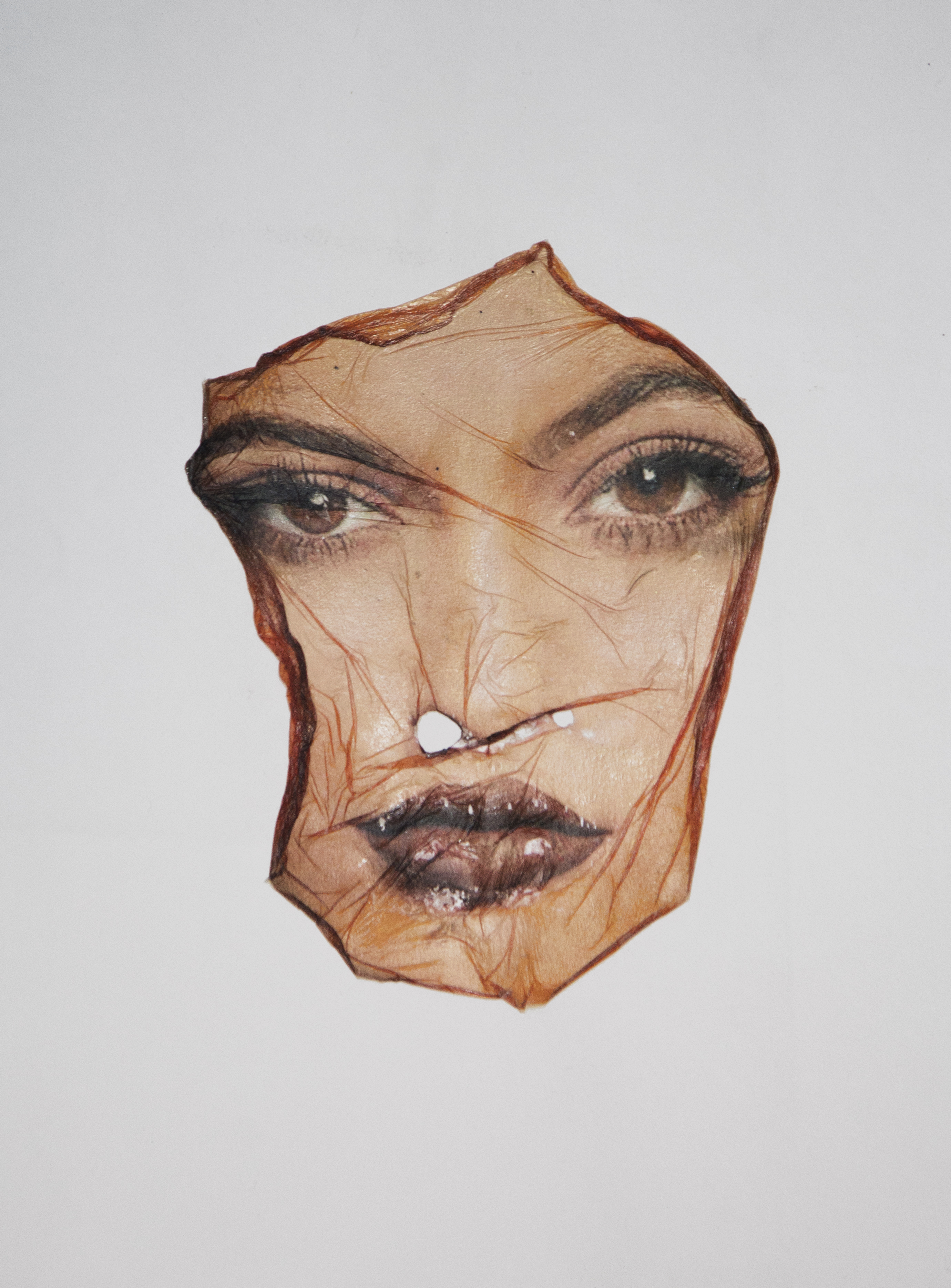 image of a warped plastic texture or fabric printed with Kylie Jenner's face