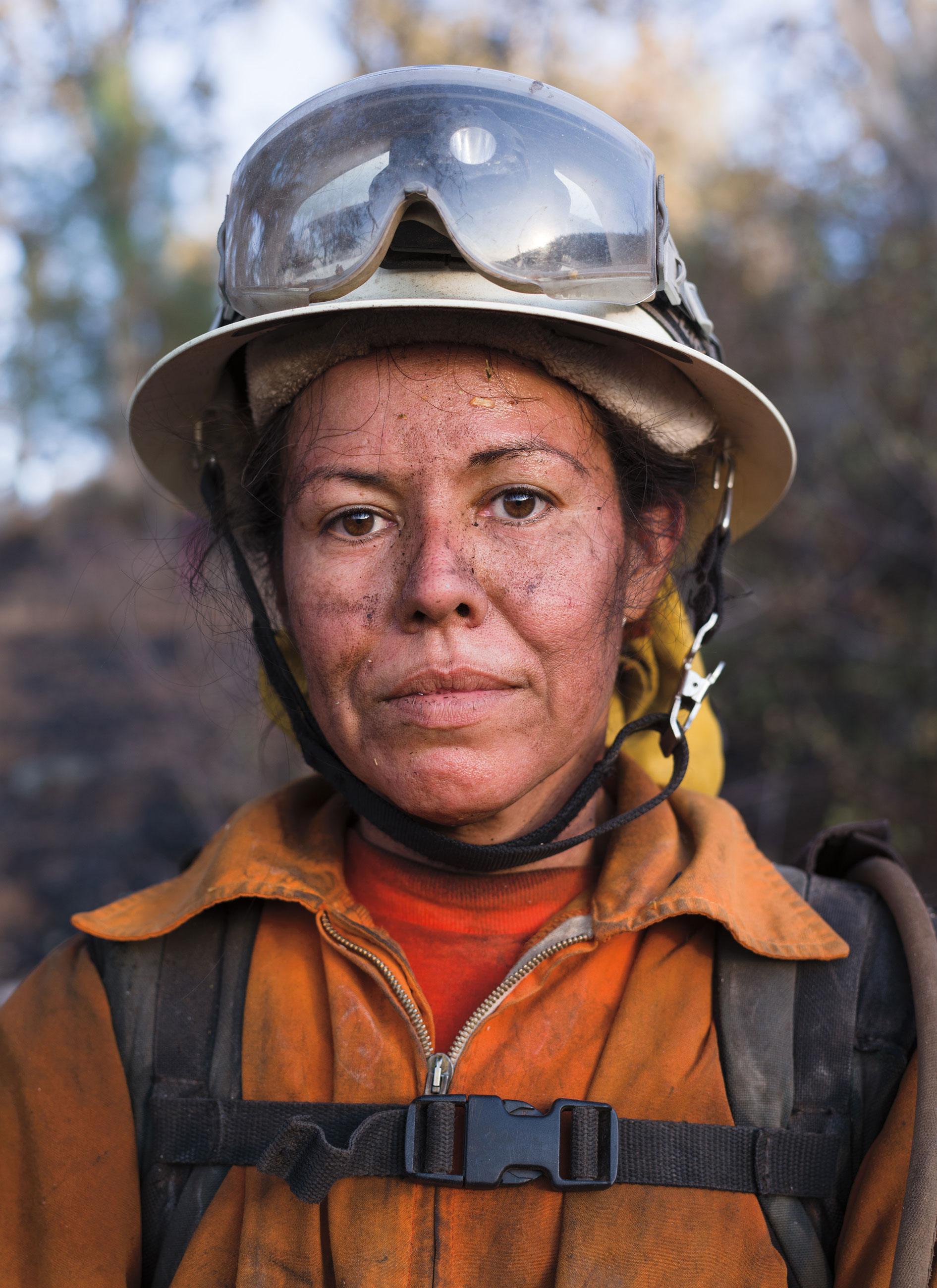 Portrait of inmate firefighter Sandra Rojas of Malibu Camp standing in front of a fire site