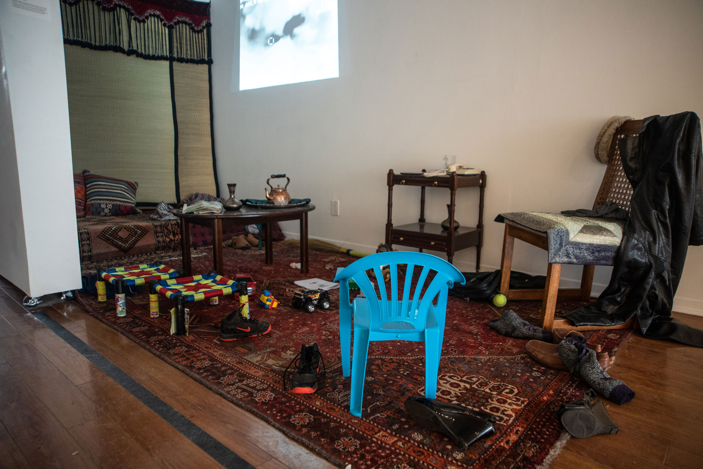 a photo captures an empty home, full of chairs and tables, but without any people