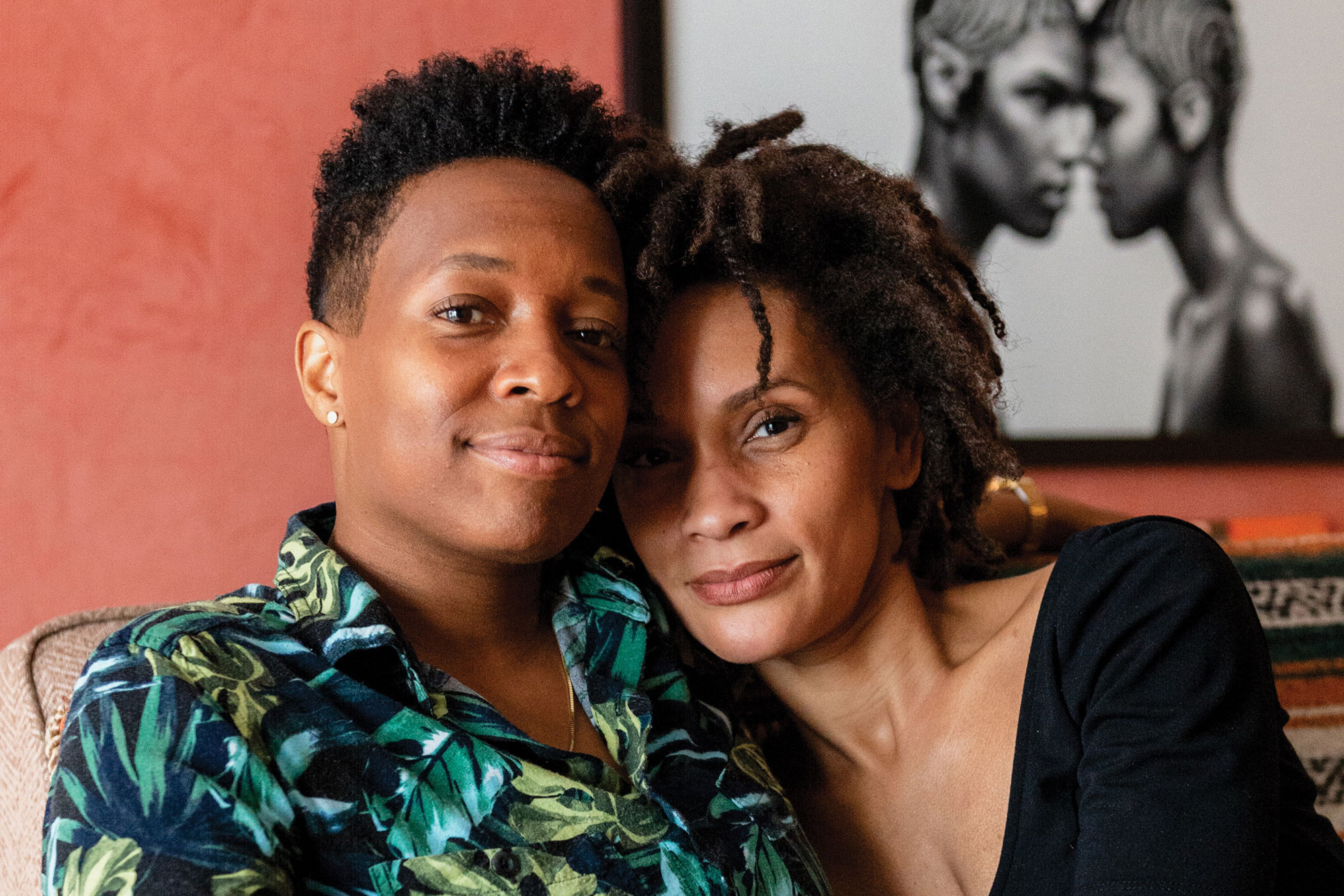 photo of wives Ayanah Moor and Jamila Raegan, two Black queer women, one with a short haircut and one with locs, in their Chicago home