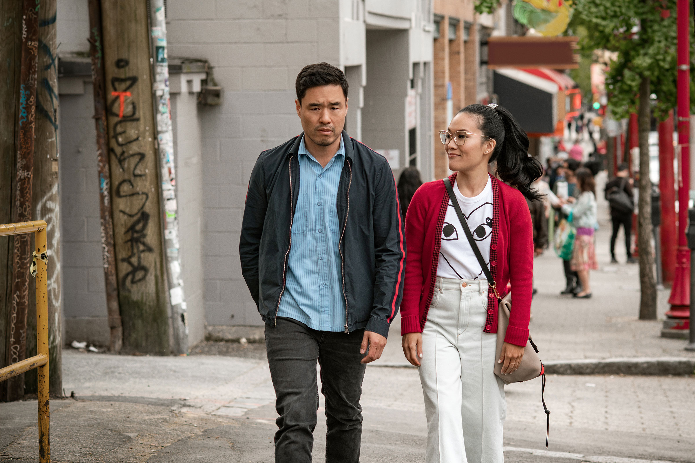 an Asian couple walks through San Francisco together in Always Be My Maybe
