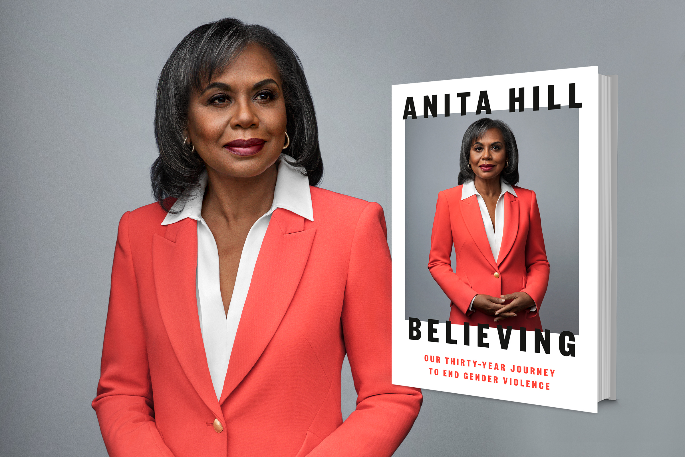 Anita Hill, a Black woman with short, black hair smiles against a gray backdrop