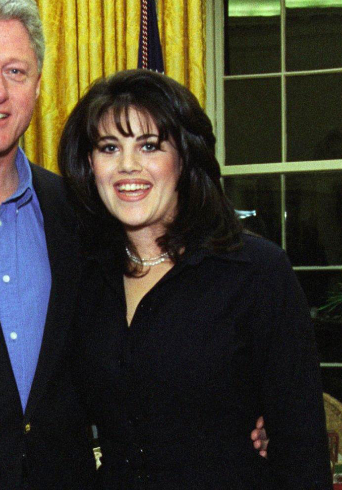 Cropped photograph of Monica Lewinsky next to President Clinton in the Oval Office, February 28, 1997