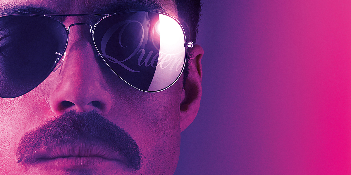 "Extreme close-up of Rami Malek playing Freddie Mercury against a gradient purple background. He has a mustache and mirrored sunglasses that say ""Queen"" on the right lens"