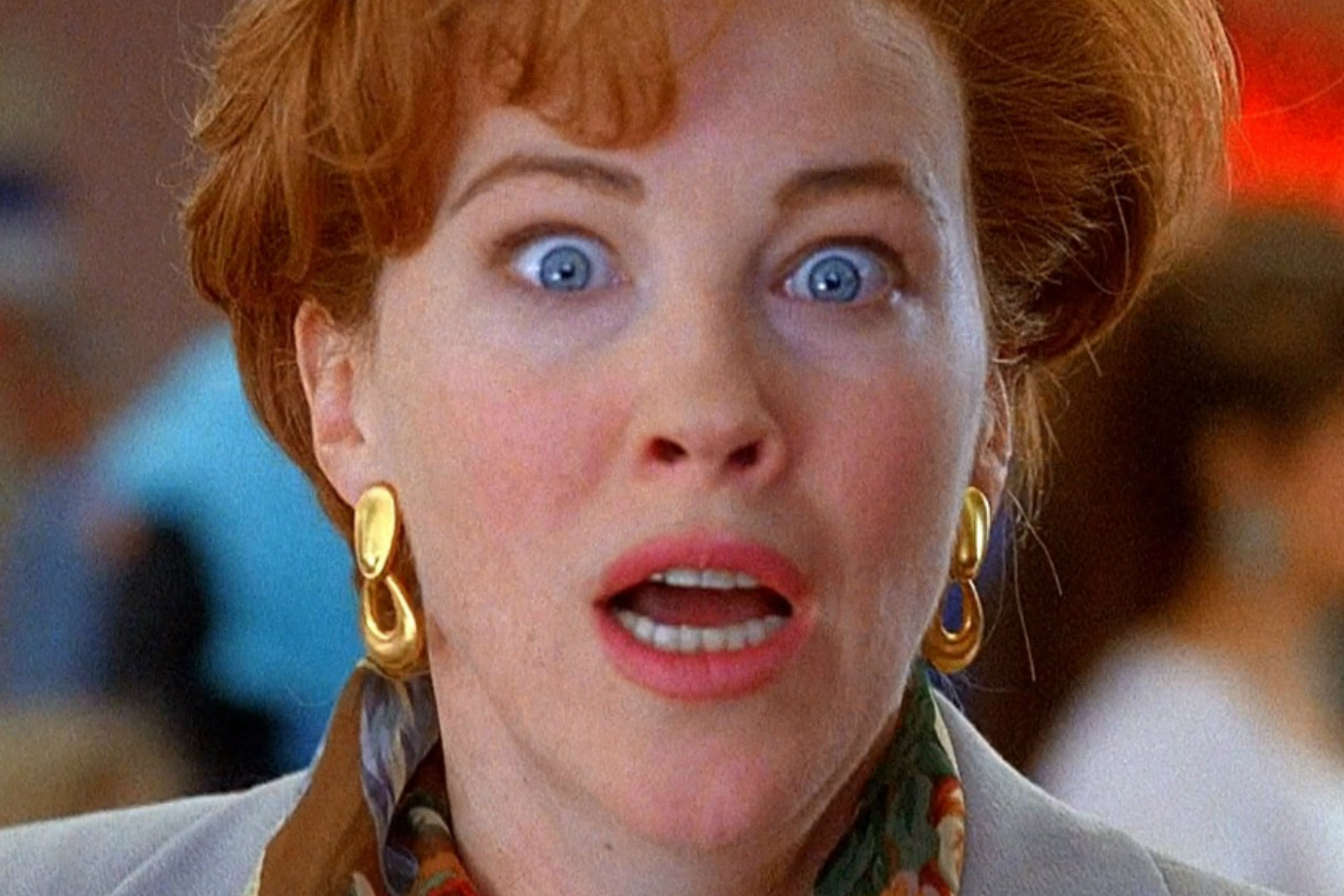 Catherine O'Hara, a white woman with short red hair who looks shocked, plays Kate McCallister in Home Alone