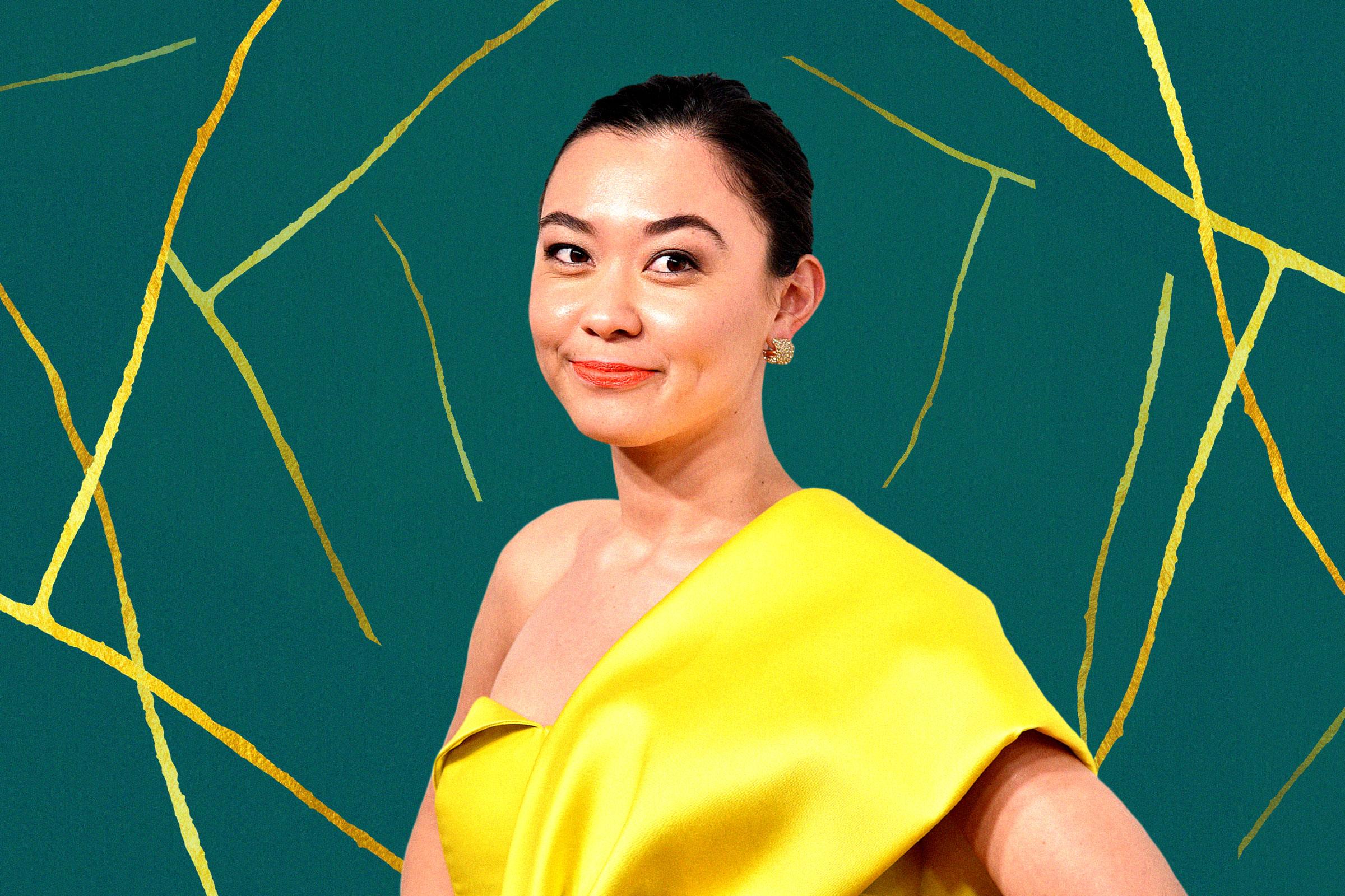Chanel Miller, a mixed-race woman with brown hair pulled into a low bun, poses in a yellow dress in front of a green and yellow background