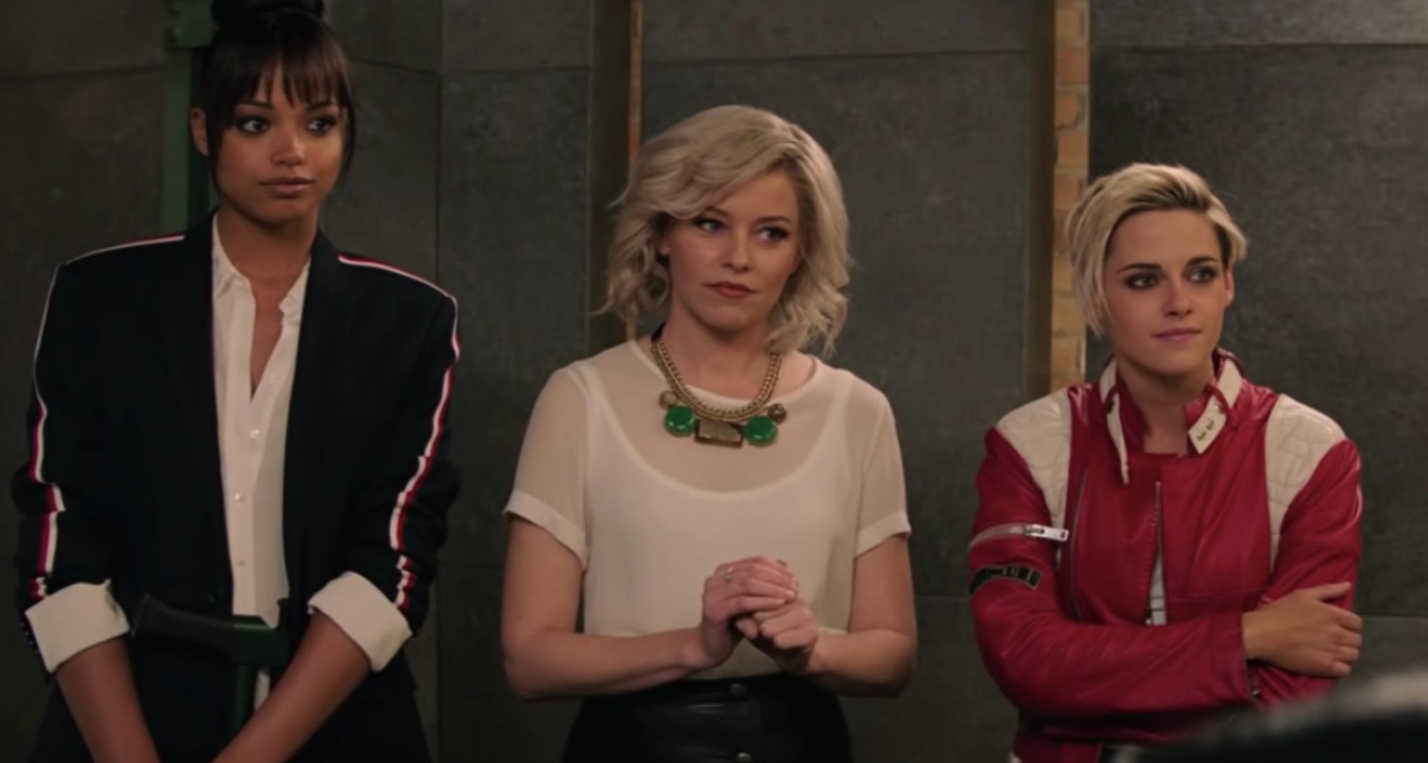 Ella Balinska as Jane Kano (left), Elizabeth Banks as Susan Bosley, and Kristen Stewart as Sabina Wilson in Charlie's Angels. All three women stand next to each other.