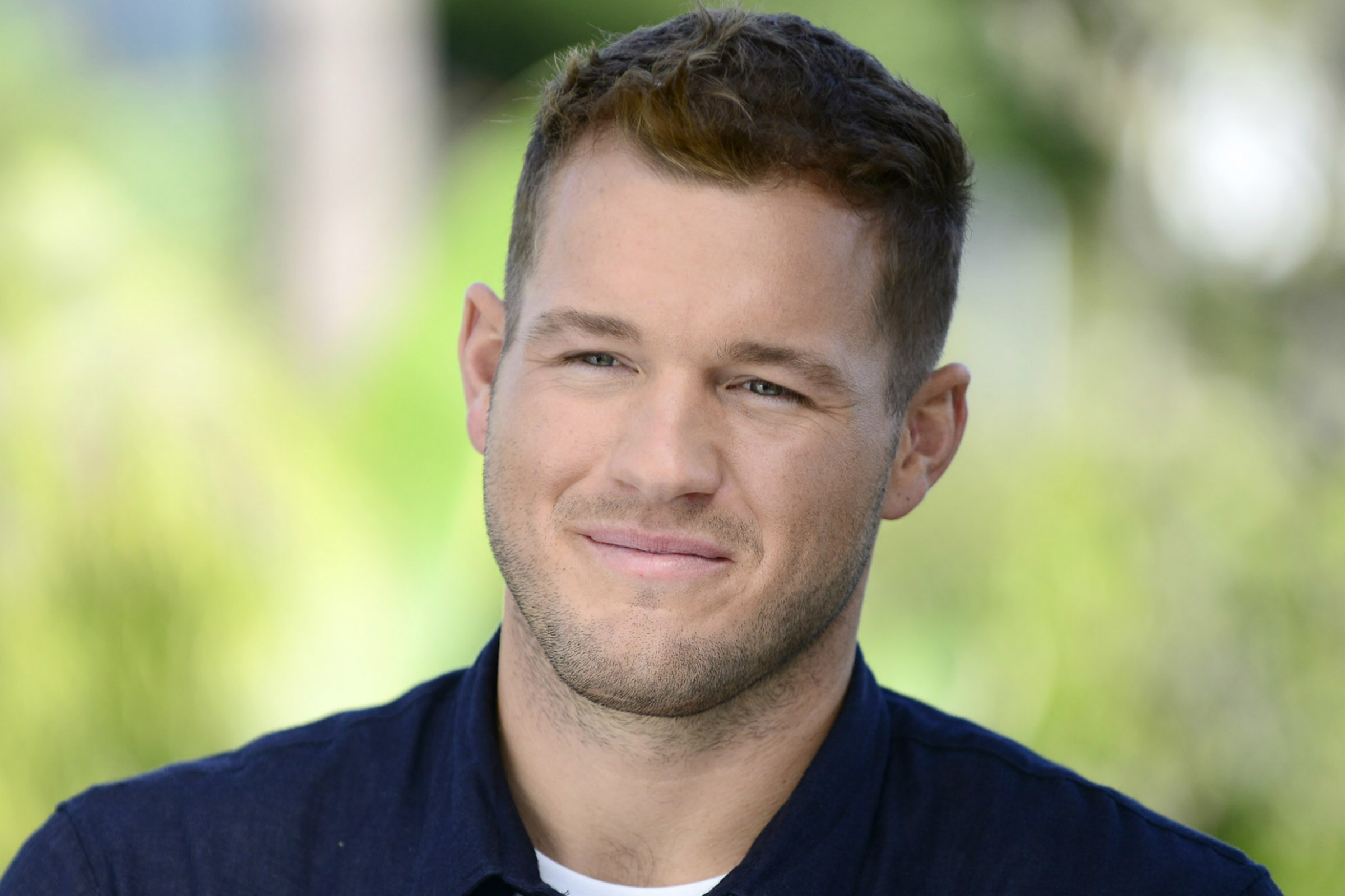 Colton Underwood, a young white man with short brown hair, smiles during an interview