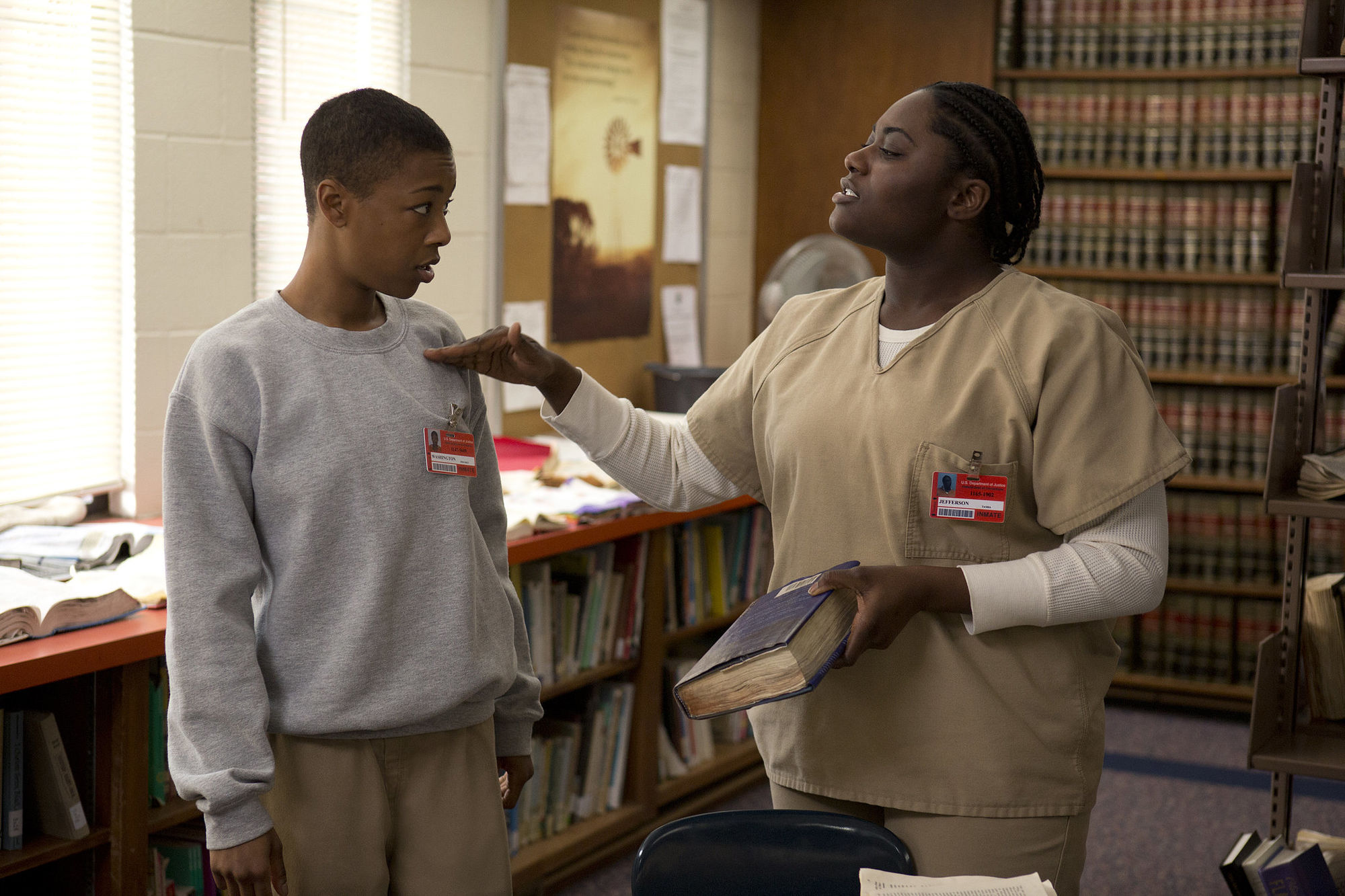 two Black women talk in a prison library on Orange is the New Black