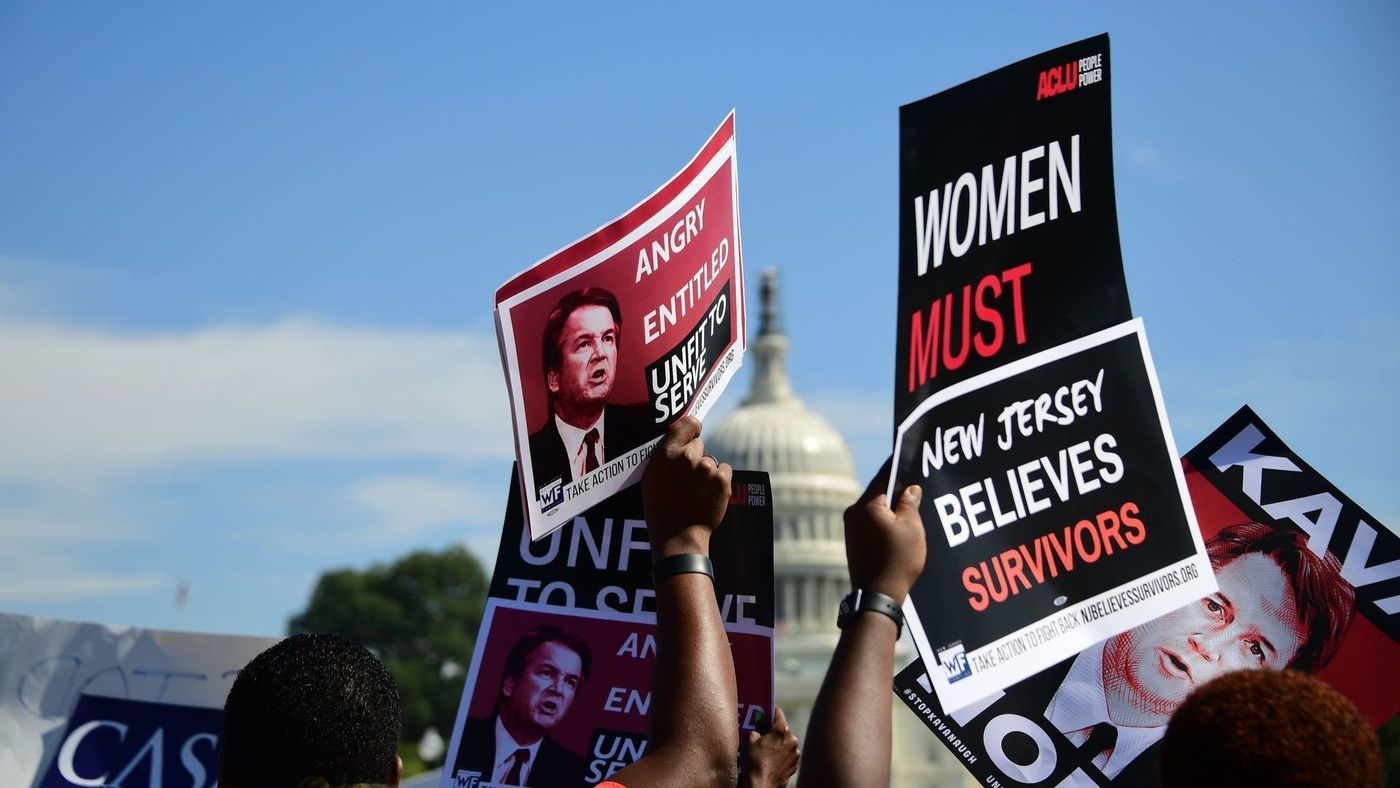 demonstrators holding signs that say Brett Kavanaugh is unfit to serve