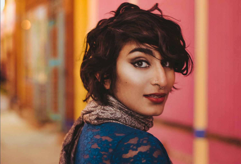 a photo of Fatimah Asghar, a brownskin woman with short, black hair