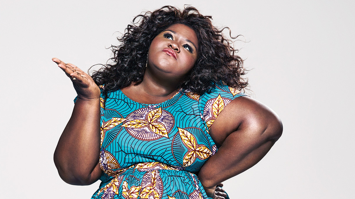 a plus-size darkskinned woman poses on a book cover