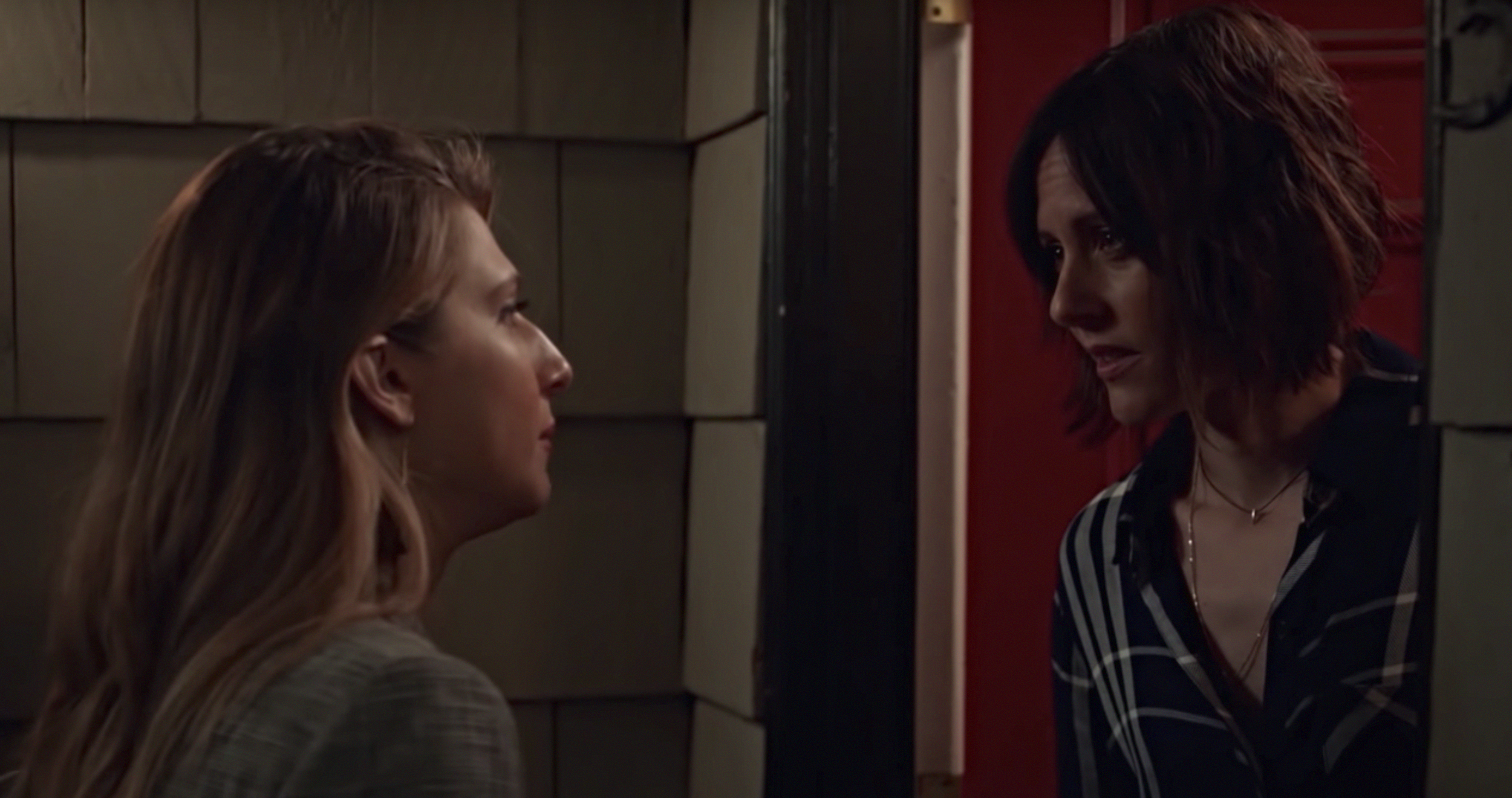 Nomi, played by Emily Arlook, a white college student with blond hair, left, and Professor Hewson, played by Katherine Moennig, a white woman with dark, short hair, on Grown-ish