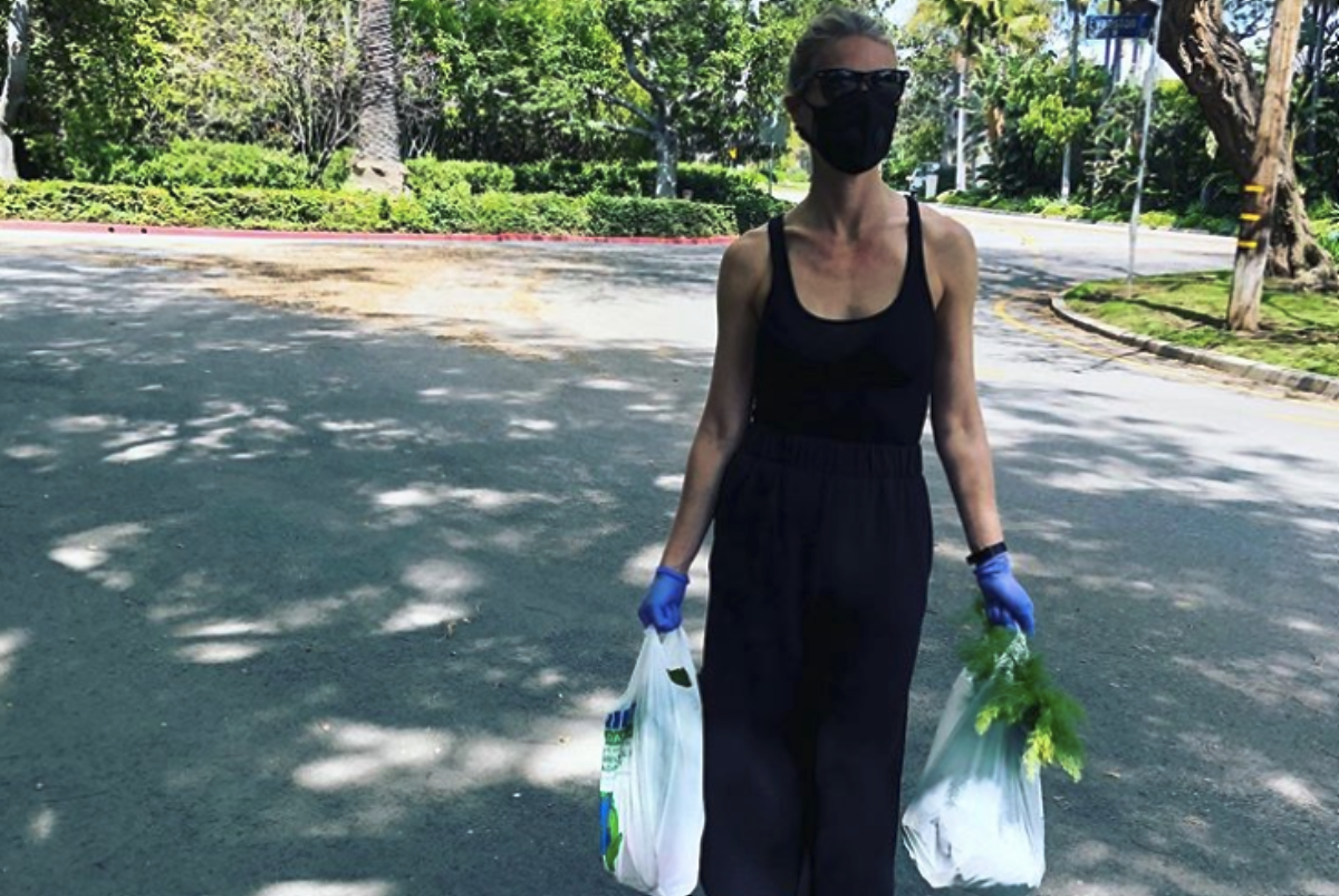 Gwyneth Paltrow, a thin white woman, wears a mask to the farmers market.