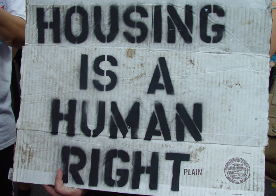 Housing Is a Human Right sign at a 2005 Republican National Convention protest in New York City