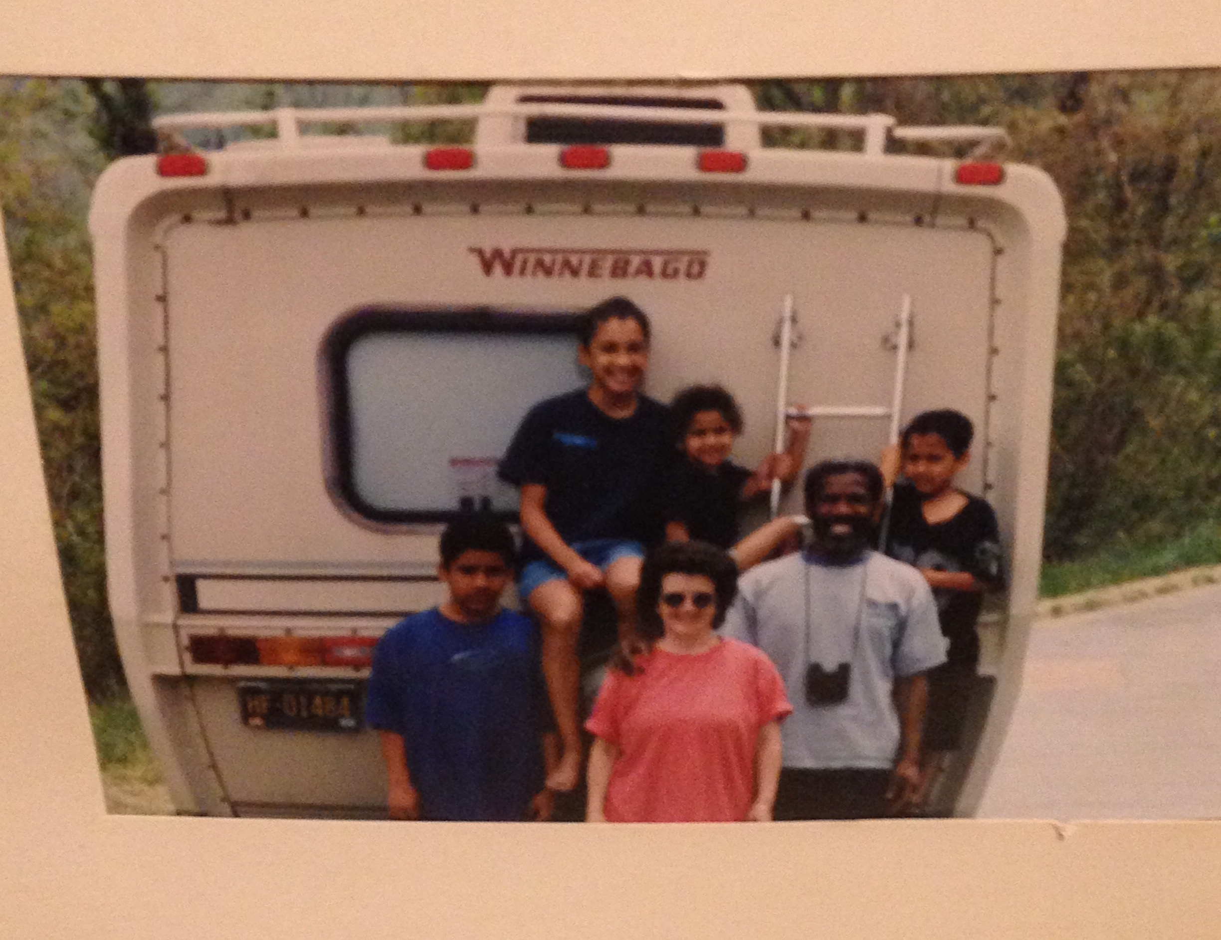 The author and her family stands by their van.