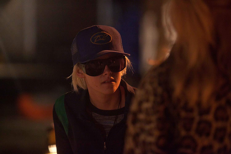 Kristen Stewart, in blond wig and cap, as JT LeRoy