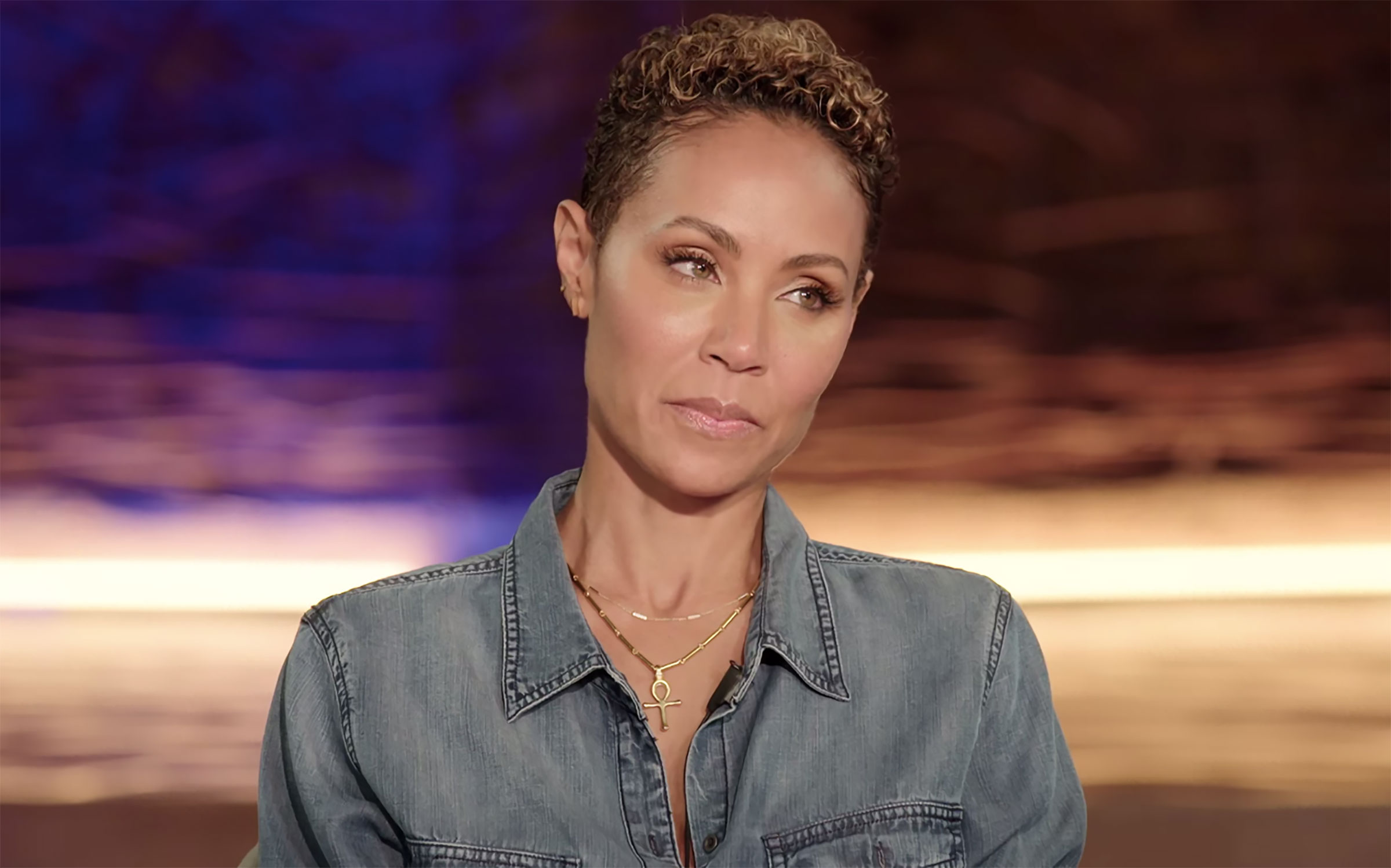 Jada Pinkett-Smith, a light-skinned Black woman with cropped, curly blond hair, on Red Table Talk