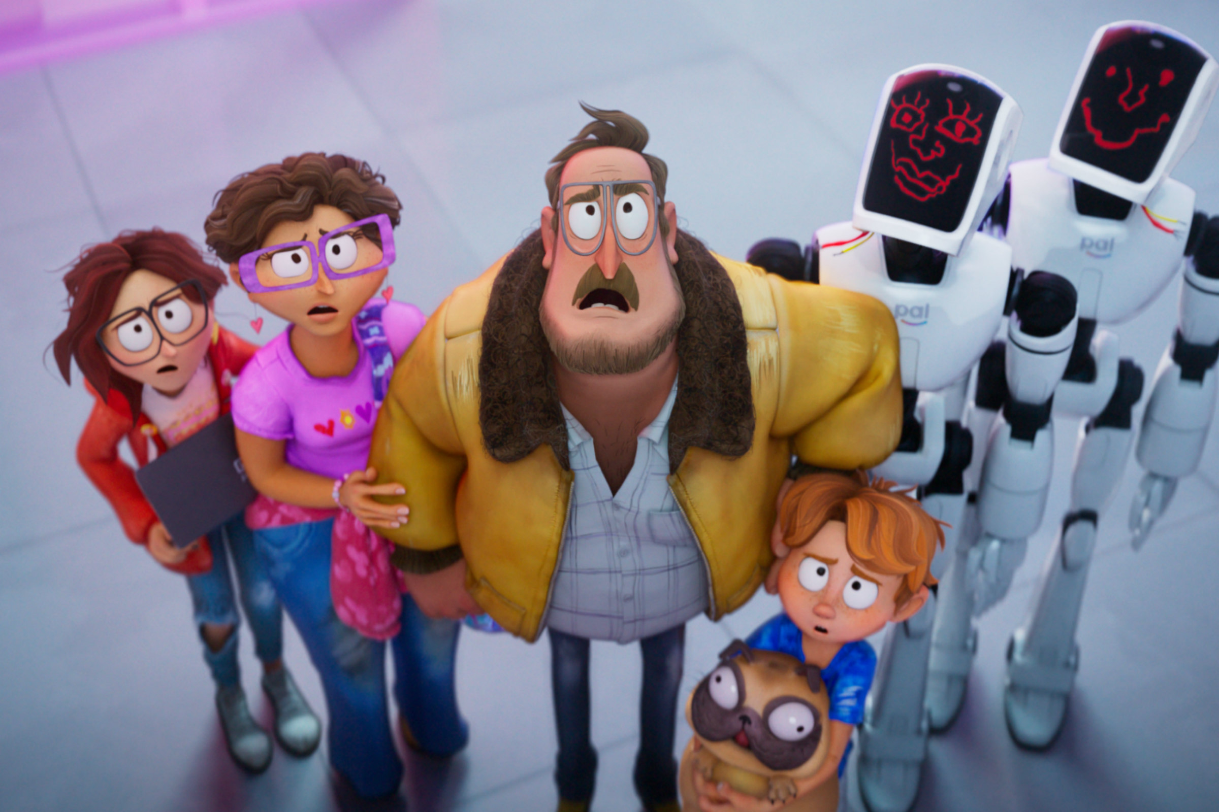 Katie, Linda, Rick, and Aaron, a white animated family, stands together with two robots in The Mitchells vs. the Machines