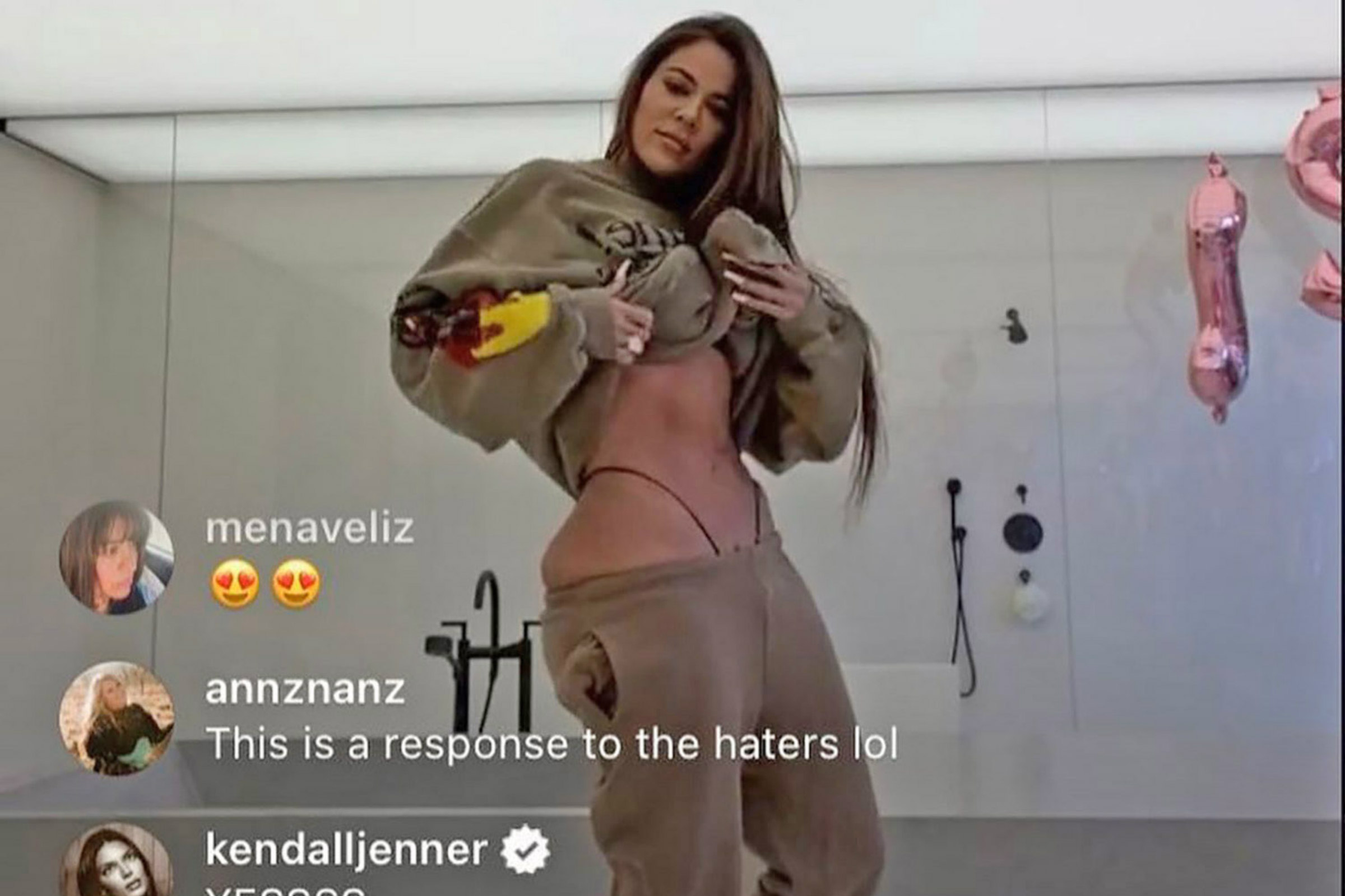 Khloé Kardashian, a tall white woman, poses on Instagram in a sweat suit and a thong