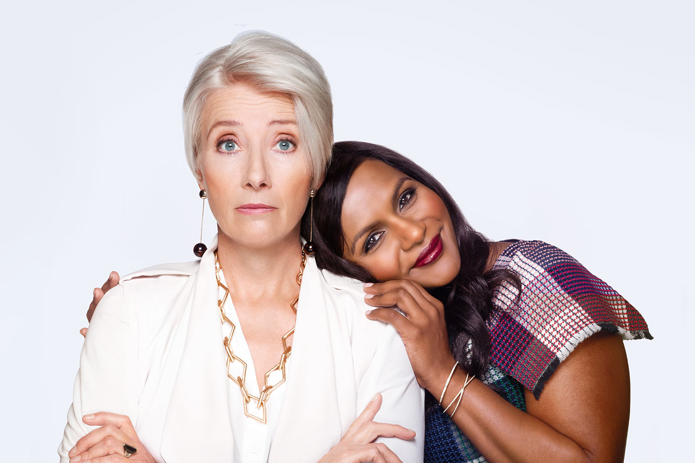 an older white woman and an Indian woman embrace in Late Night
