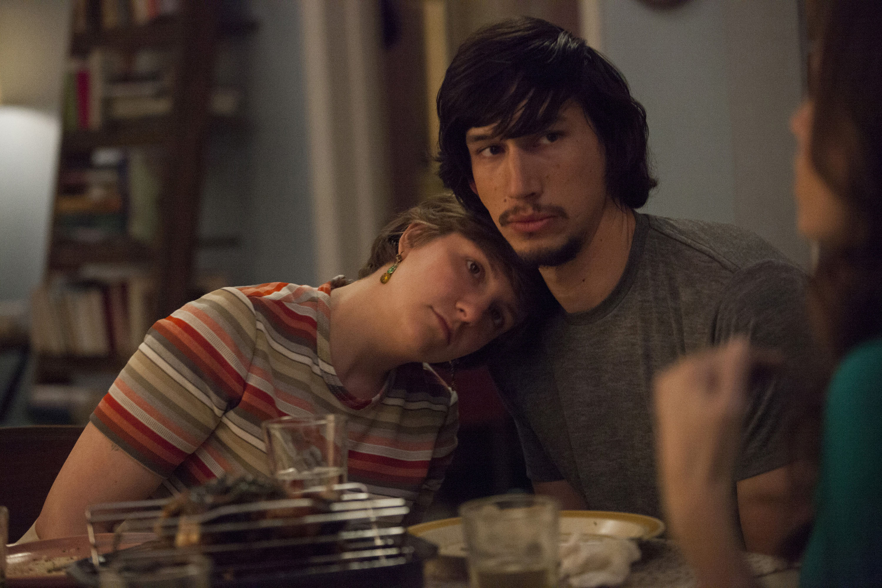 a white woman and a white man cuddle at the kitchen table on HBO's Girls