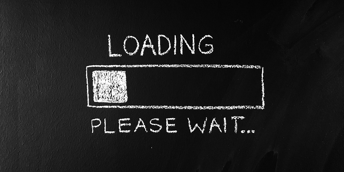 "An illustration of a loading bar and the words ""Loading please wait"" written in white chalk on a blackboard"