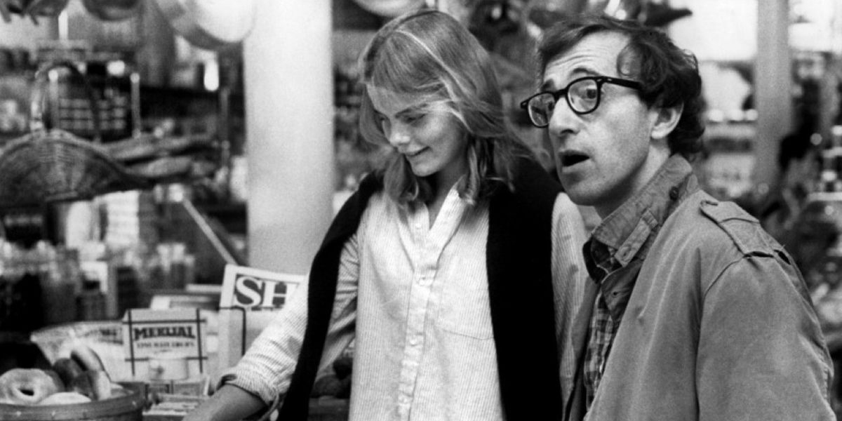 Woody Allen stares off screen, mouth agape, while his teenage girlfriend (played by Mariel Hemingway) grins