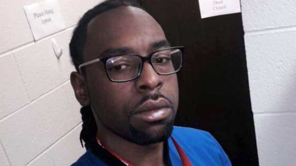 Philando Castile, a darkskinned Black man in a blue t-shirt, poses for a selfie in a bathroom