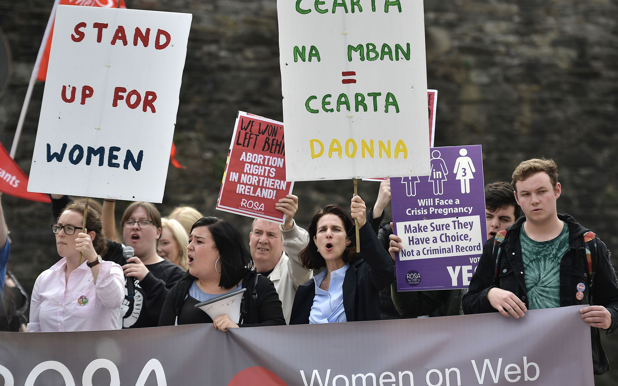 In this photo, Doctor Rebecca Gomperts, a white woman, (2nd R) leads supporters in a chant as the abortion rights campaign group ROSA, Reproductive Rights Against Oppression, Sexism and Austerity hold a rally in Ireland.