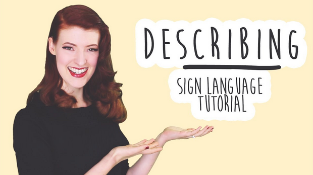"""Screen shot of smiling red-haired woman next to the words """"Describing: Sign Language Tutorial"""