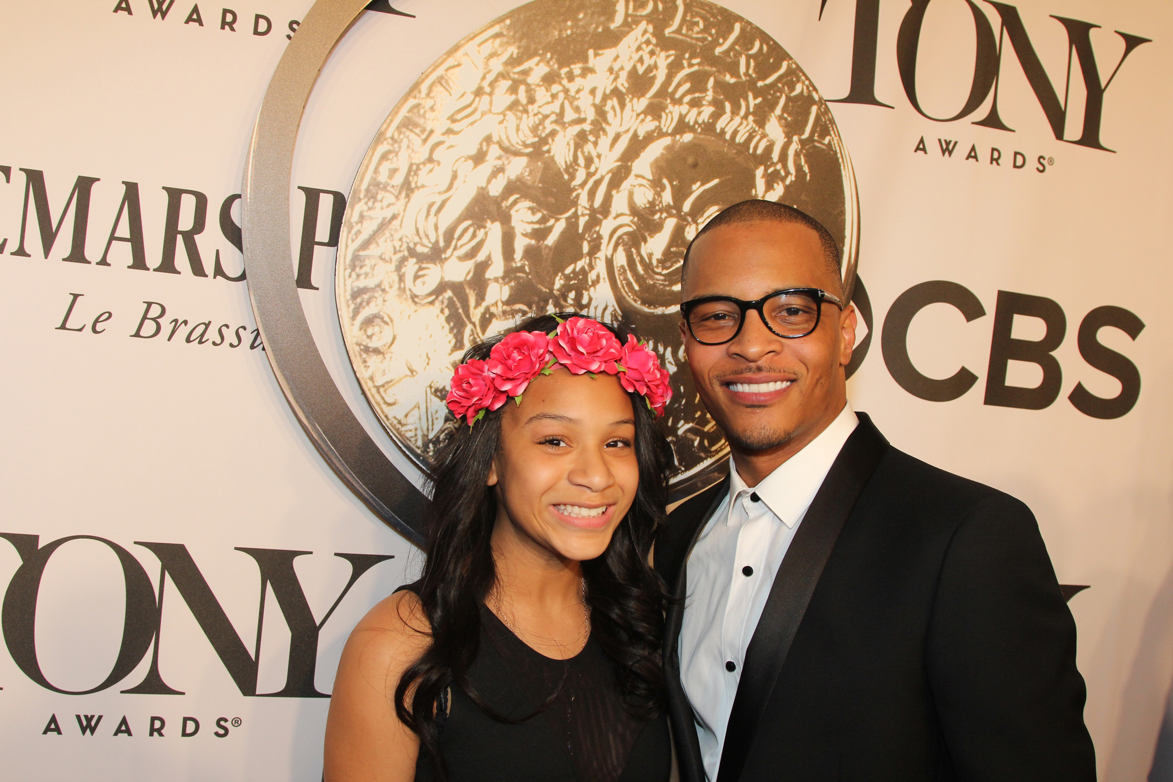 T.I. and his daughter Deyjah, who are both lightskinned Black people wearing formal clothes, attend an awards ceremony together