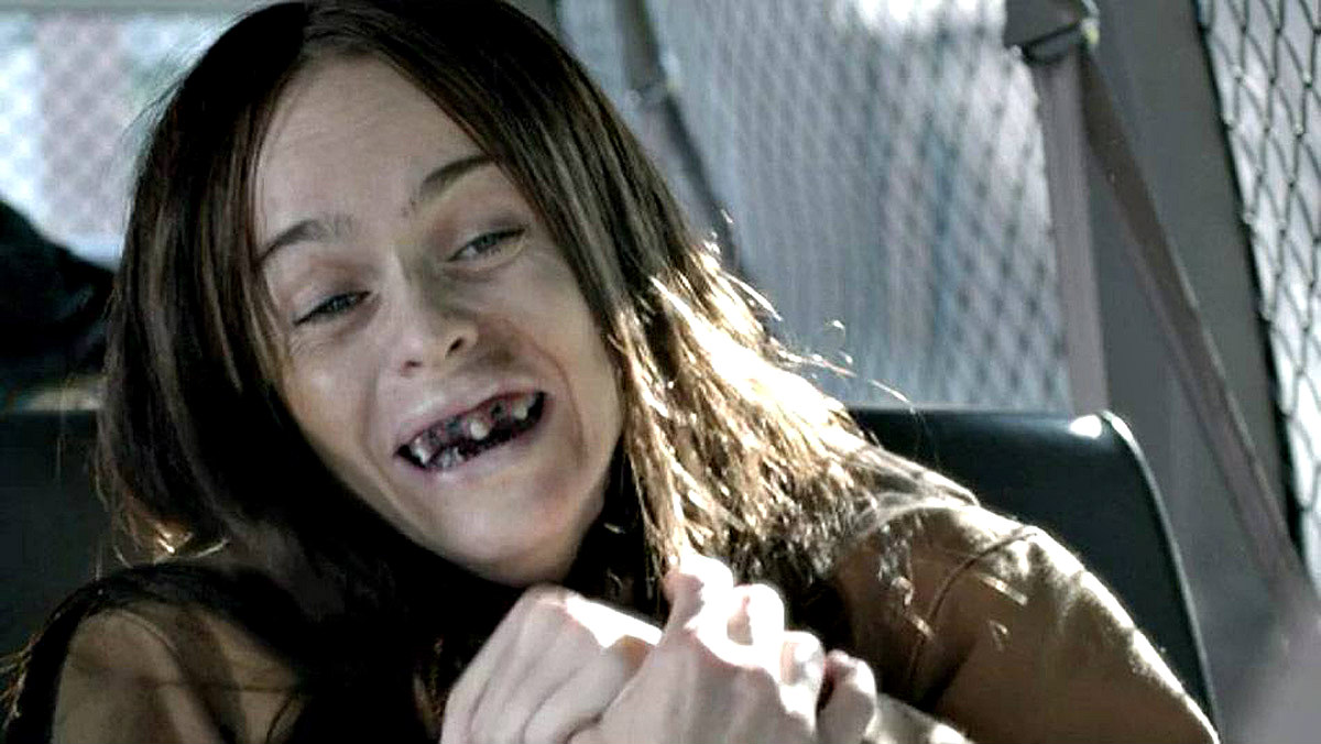 a white woman prisoner cries and her rotted teeth show